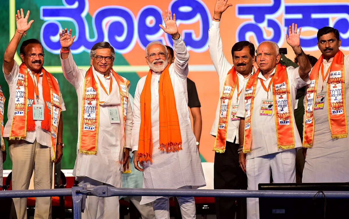 Former Congress Union Minister and now BJP leader SM Krishna, with Prime Minister Narendra Modi, at Bengaluru on April 13, 2019. (Photograph: PTI)