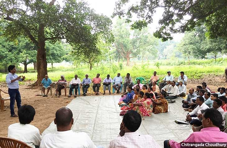 Gladson Dundung (left) during a village meeting on land and forest policies in Khunti, Jharkhand.