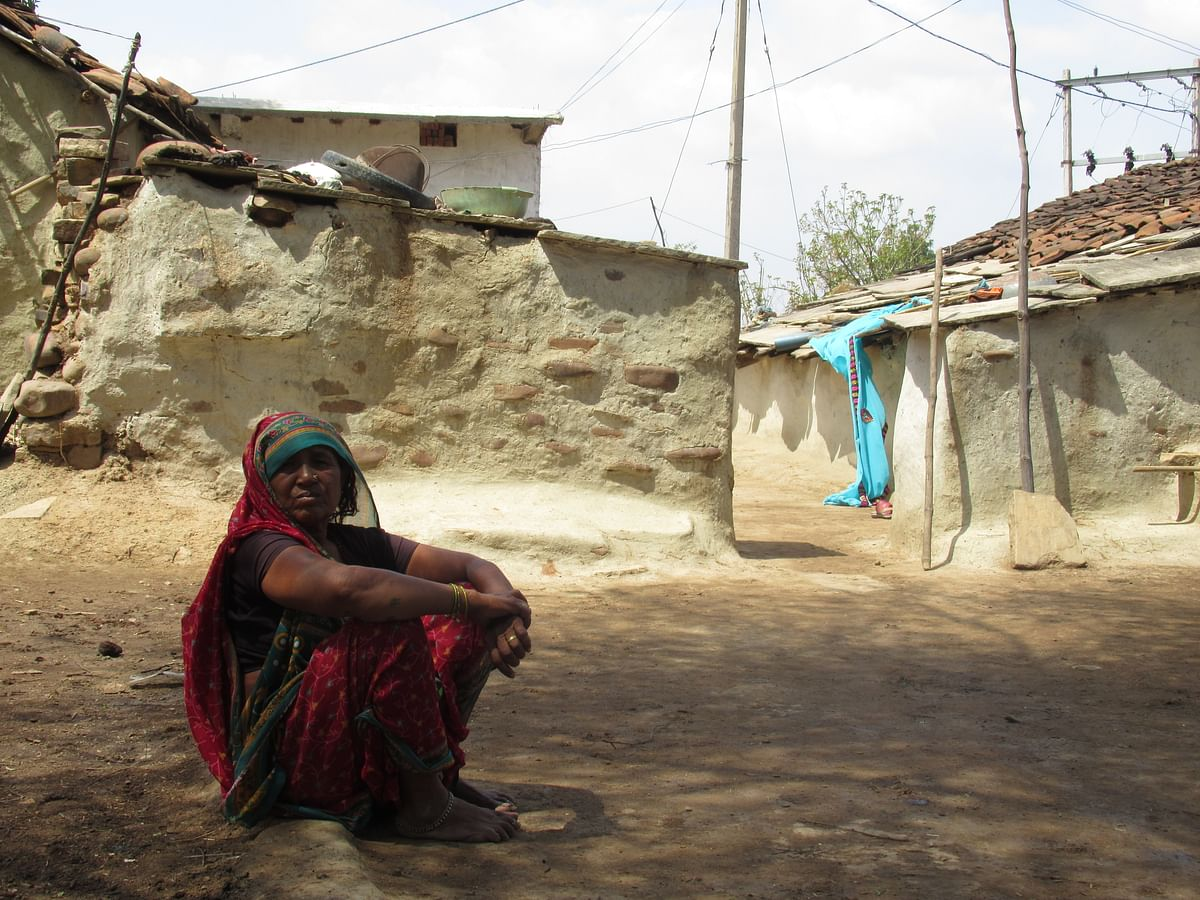 Suniya Gon sits outside her hut inKalyanpur, a village in the district of Panna (Photo: Parth MN/BloombergQuint)