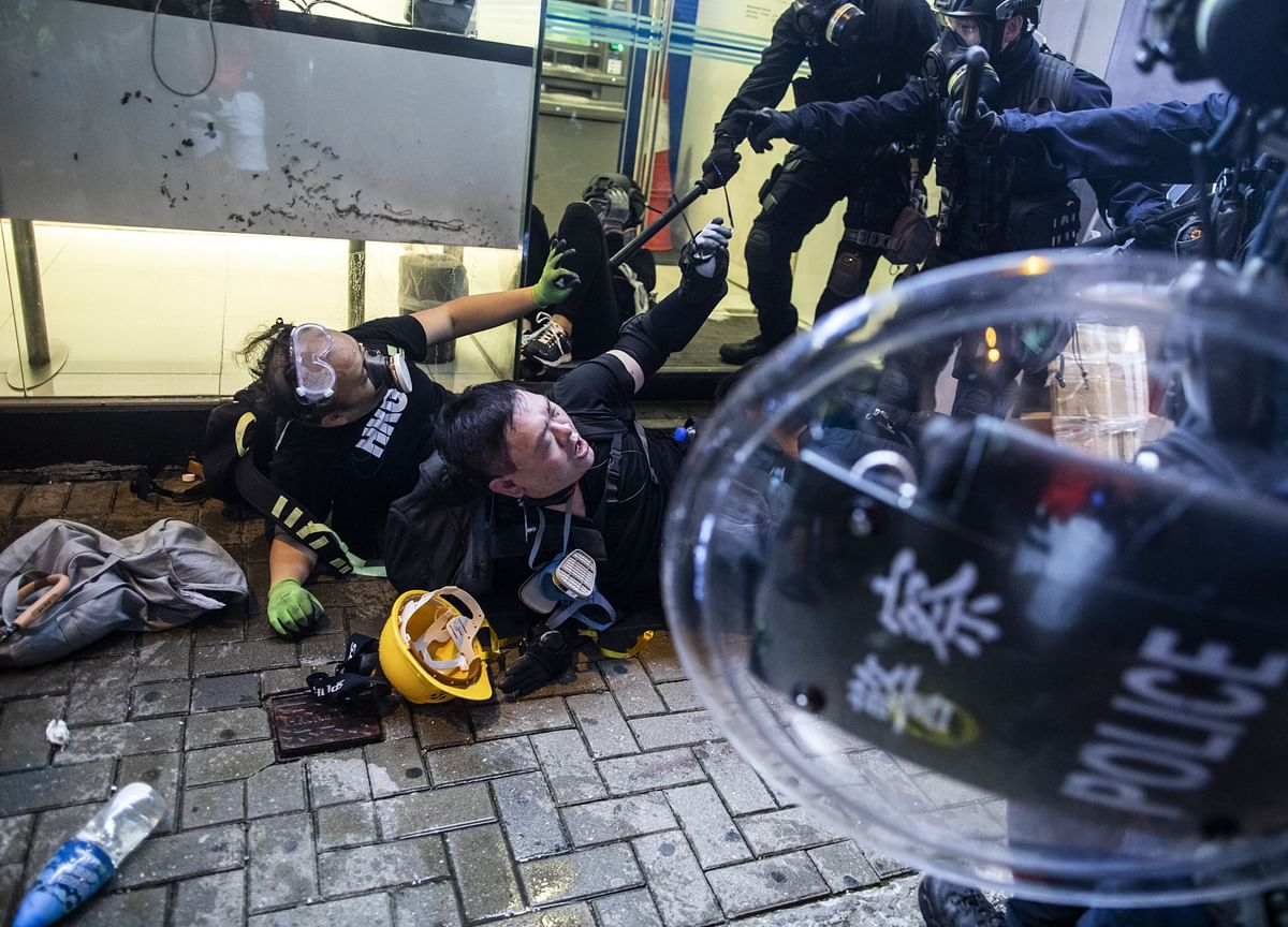 Hong Kong Rioting Charges Signal Harsher Line Against Protesters