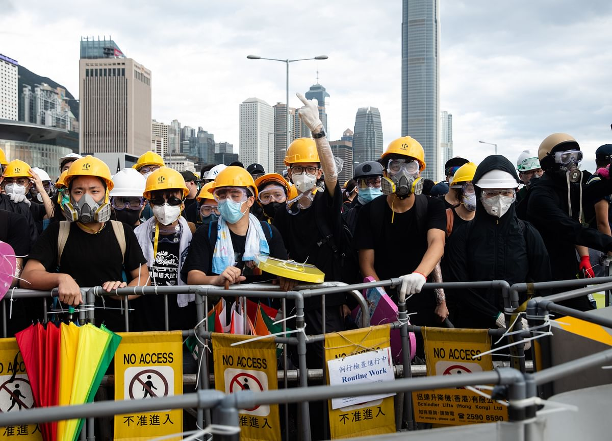 Riot Police Fire Tear Gas to Clear Protesters in Hong Kong
