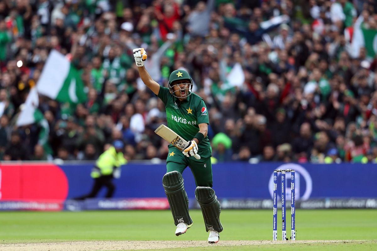 Pakistan's Babar Azam celebrates scoring a century, on the way to defeating New Zealand, in Birmingham, on June 26, 2019. (Photograph: AP/PTI)