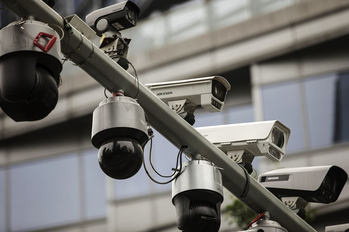 Surveillance cameras  are mounted on a post at a testing station  in Hangzhou, China, on  May 28, 2019. (Photographer: Qilai Shen/Bloomberg)