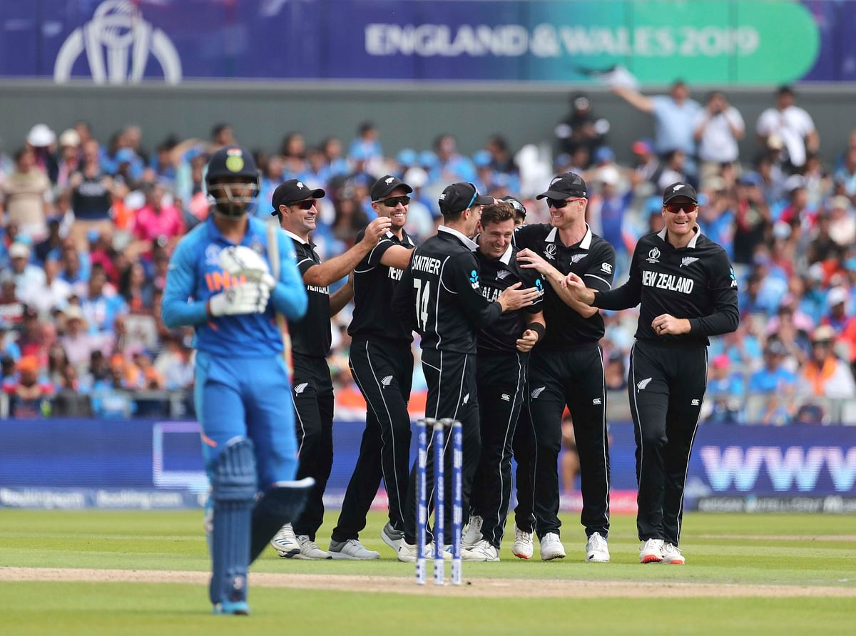 Matt Henry celebrates a wicket with teammates during the Cricket World Cup semi-final between India and New Zealand, in Manchester, on  July 10, 2019. (Photograph: AP/PTI)