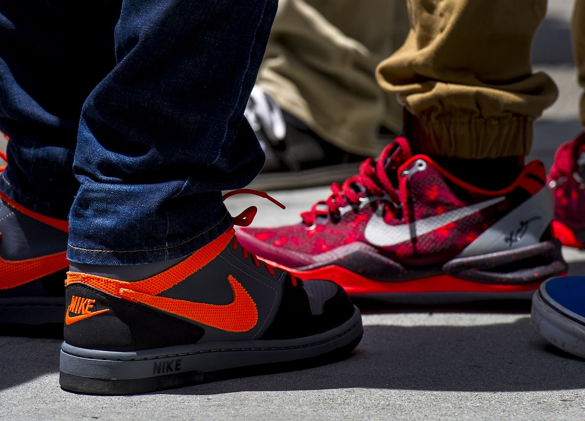 Nike, Adidas Output Snarled as Covid Shuts Asian Factories