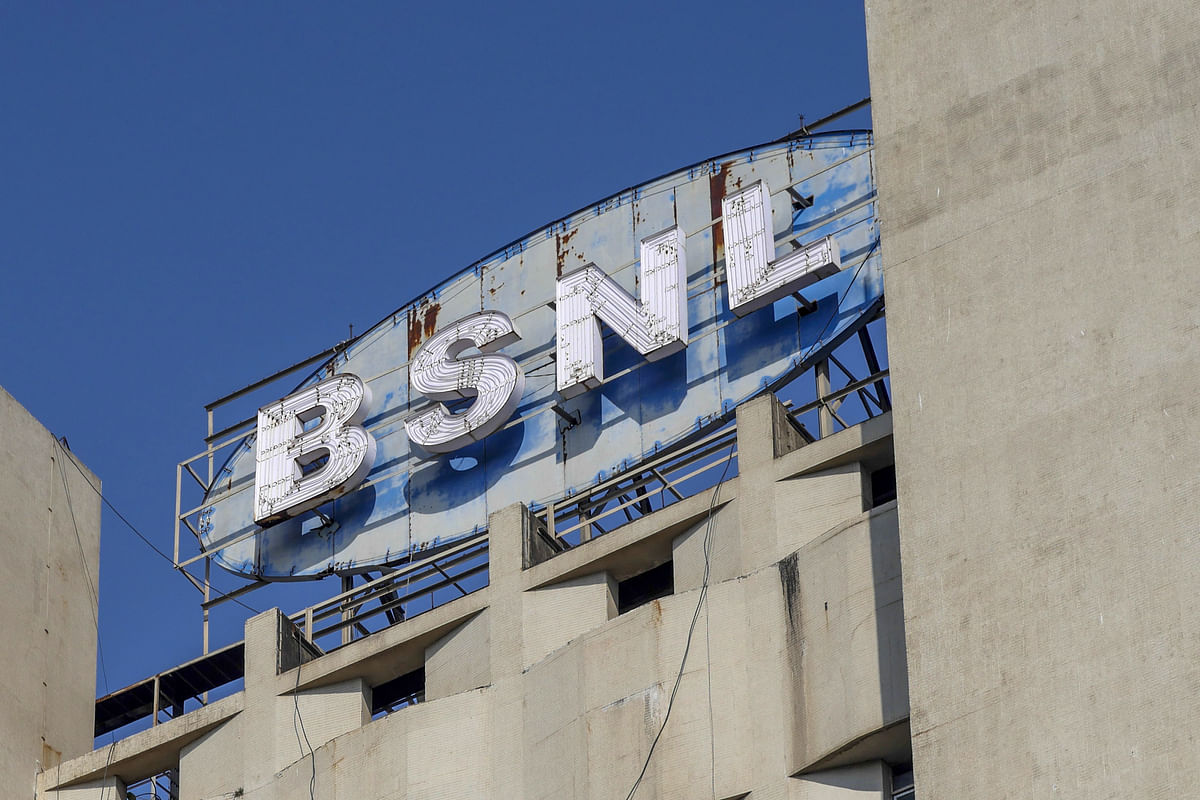Signage for Bharat Sanchar Nigam Ltd. (BSNL) is displayed atop the company's head office in the Churchgate area of Mumbai. Photographer: Dhiraj Singh/Bloomberg