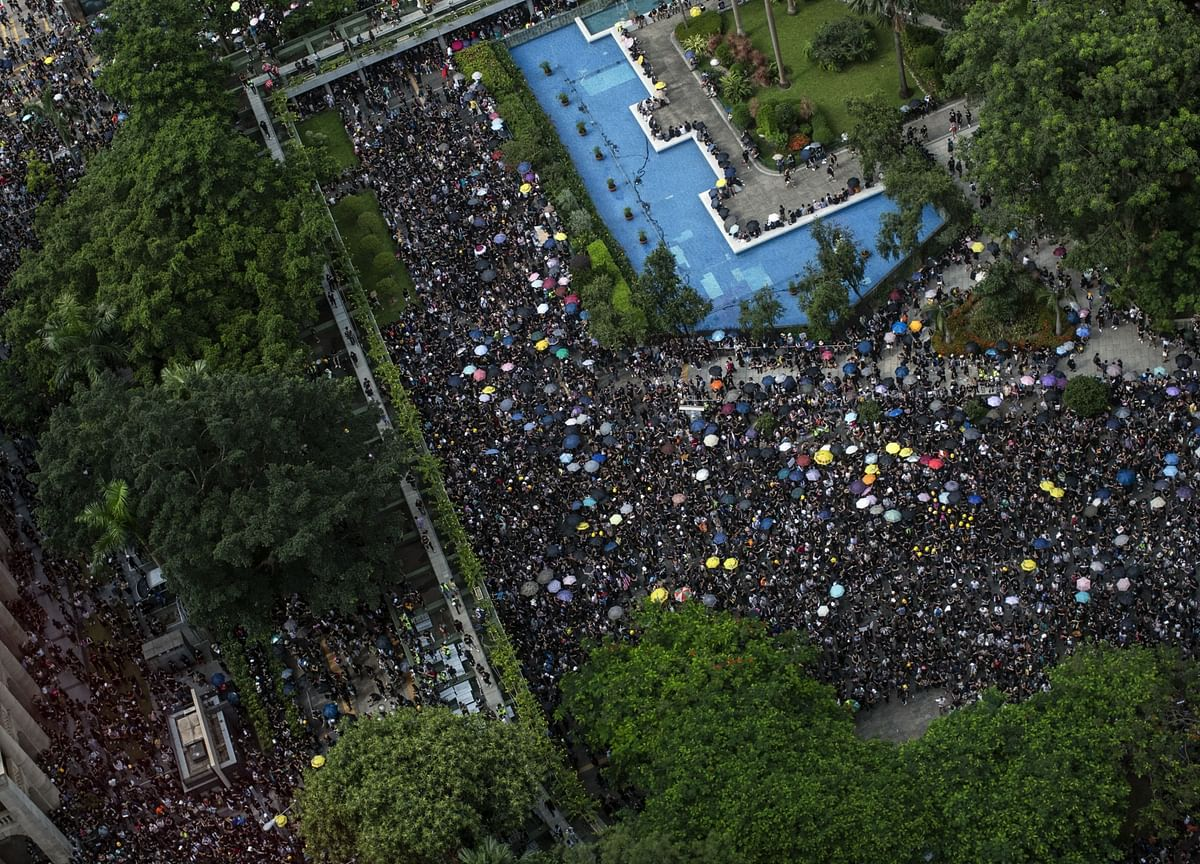 Hong Kong's Economy Hit by Protests, Finance Secretary Chan Says
