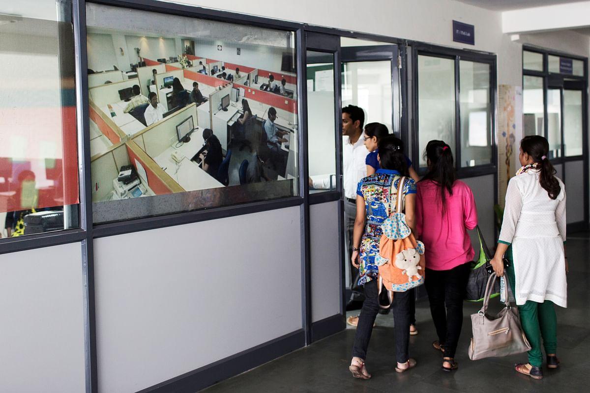 Young women enter a skilling institute in New Delhi. (Photograph: Udit Kulshrestha/Bloomberg)