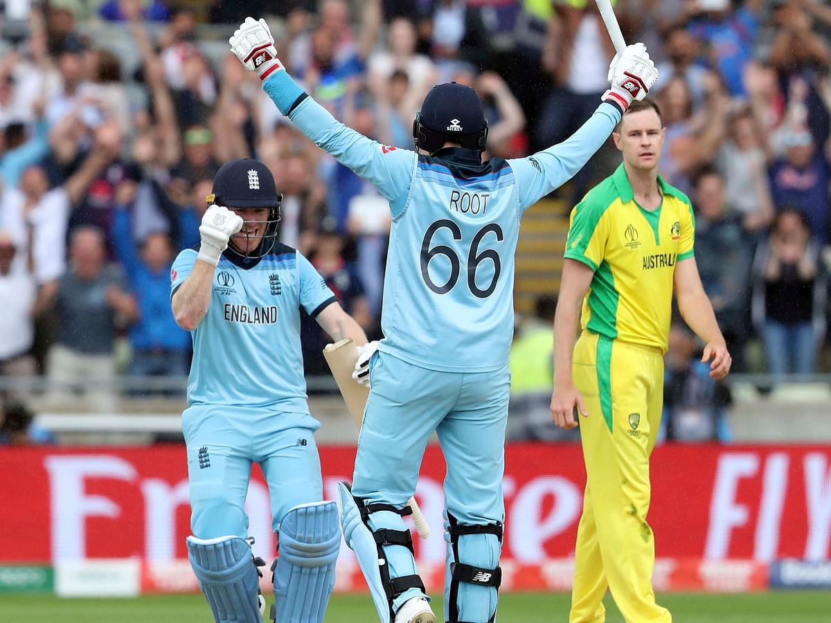 England's Eoin Morgan and Joe Root celebrate after beating Australia, in the Cricket World Cup semi-final, in Birmingham, on July 11, 2019. (Photograph: AP/PTI)
