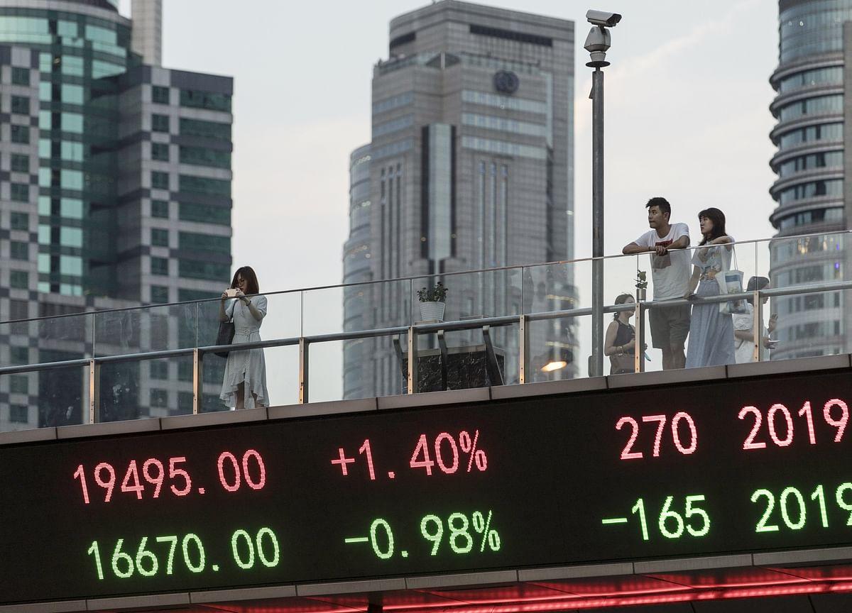 Asia Stock Investors Look Ahead to September Reprieve