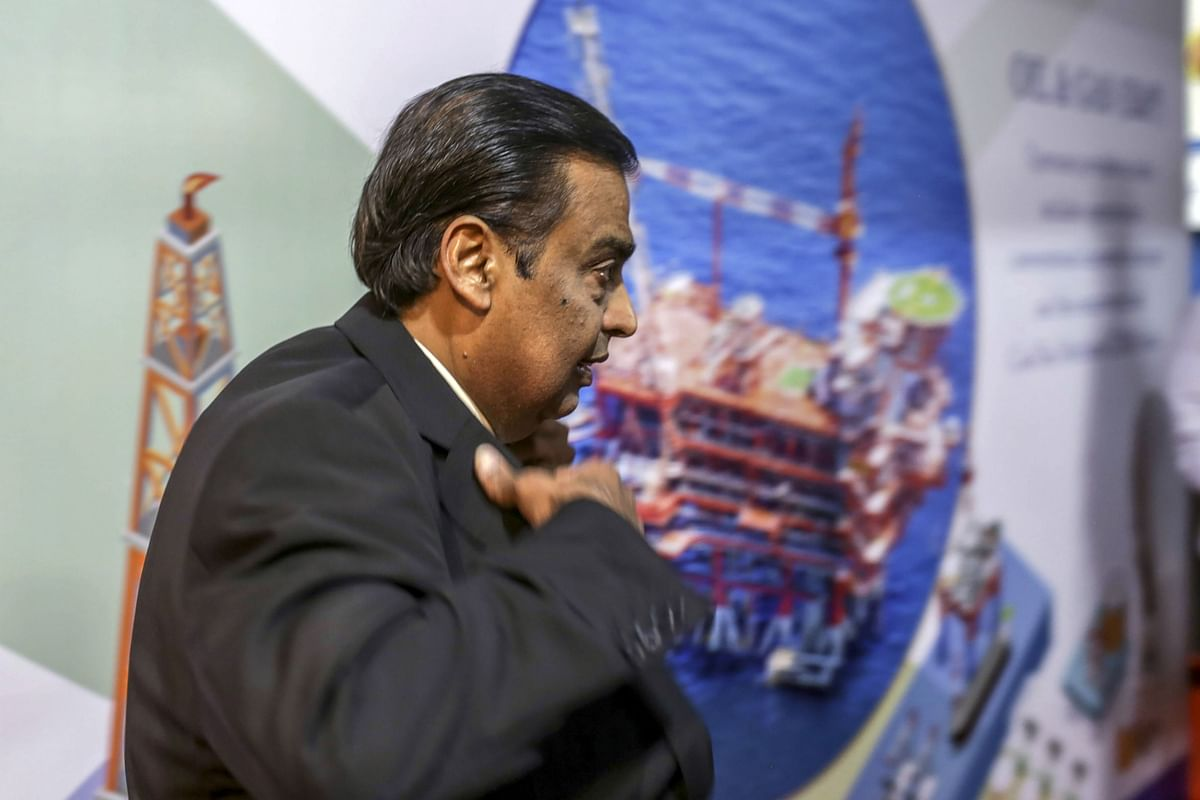 Mukesh Ambani, chairman and managing director of the Reliance Industries Ltd., arrives for the company's annual general meeting in Mumbai, India. (Photographer: Dhiraj Singh/Bloomberg)