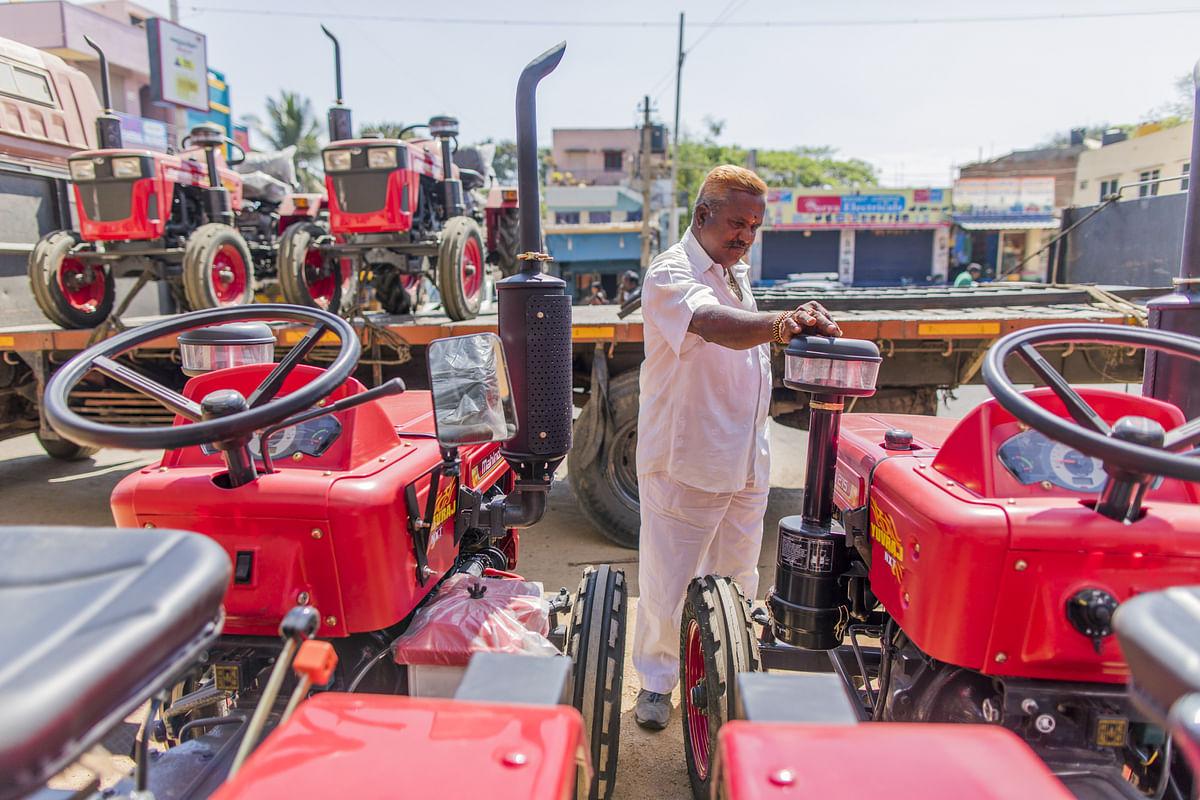 A customer looks at a Mahindra Yuvraj 215 NXT tractor, at a dealership in Tumakuru, Karnataka, on March 8, 2018. (Photographer: Prashanth Vishwanathan/Bloomberg)