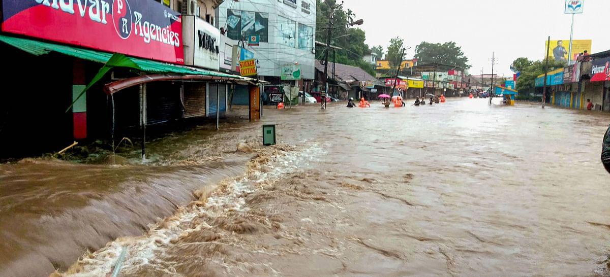 A flooded street following incessant monsoon rainfall, at Kalpetta in Wayanad. (Source: PTI)