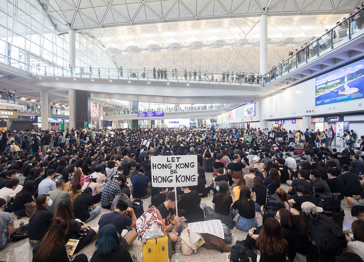 Hong Kong Cancels All Remaining Monday Flights as Protesters Swarm Airport