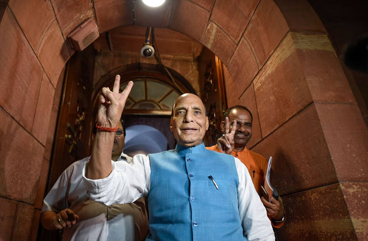 Defence minister Rajnath Singh flashes a victory sign after the Lok Sabha was adjourned. (Source: PTI)
