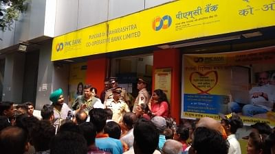 """<div class=""""paragraphs""""><p>An earlier photograph of depositors and investors gathered outside Bhandup Branch of the Punjab &amp; Maharashtra Cooperative (PMC) Bank, in Mumbai.</p></div>"""