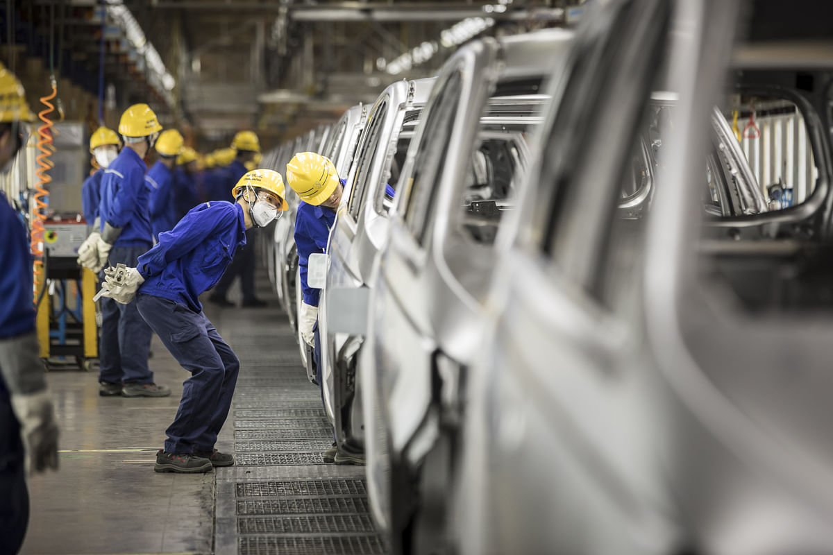 Workers inspect vehicles in the weld shop at the SAIC-GM-Wuling Automobile plant, in Liuzhou, Guangxi province, China. (Photographer: Qilai Shen/Bloomberg)