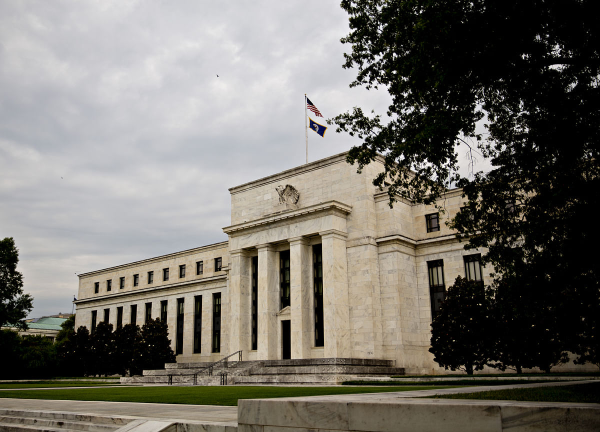 Fed Doves Fear Risks Abroad While Hawks See a Solid Home Front