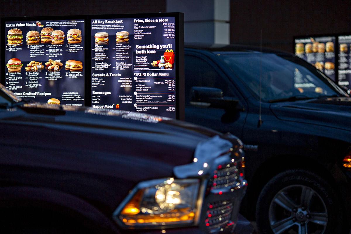 A digital menu board is displayed in the drive-thru of a McDonald's (Photographer: Daniel Acker/Bloomberg)