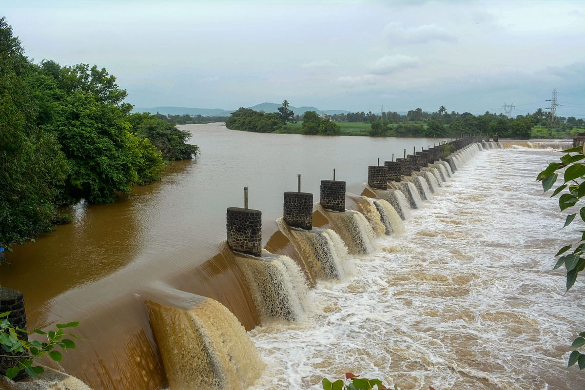 Water from the Krishna River overflows from the Khodshi dam, following monsoon rains near Karad in Maharashtra. (Photograph: PTI)
