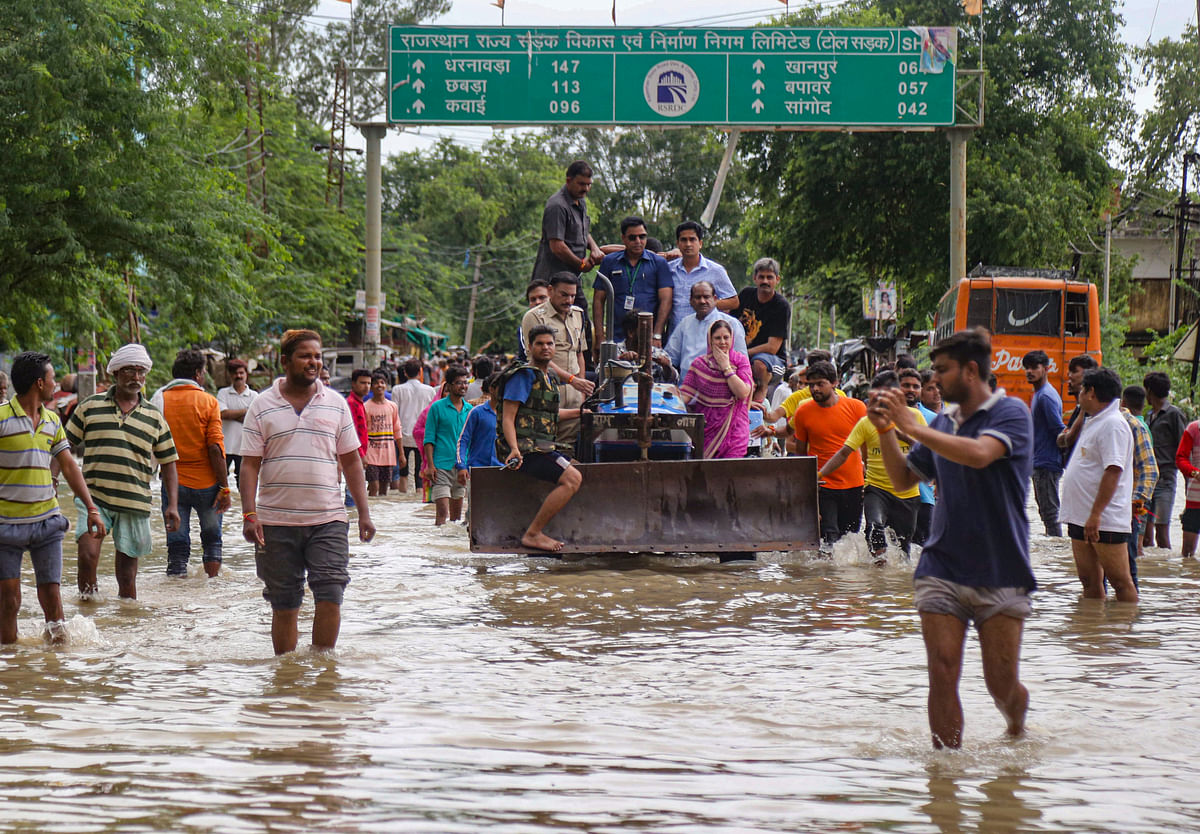 Lok Sabha Speaker Om Birla rides on a tractor as he visits the flood-affected areas in Kota, Rajasthan, on Aug. 16, 2019. (Photograph: PTI)
