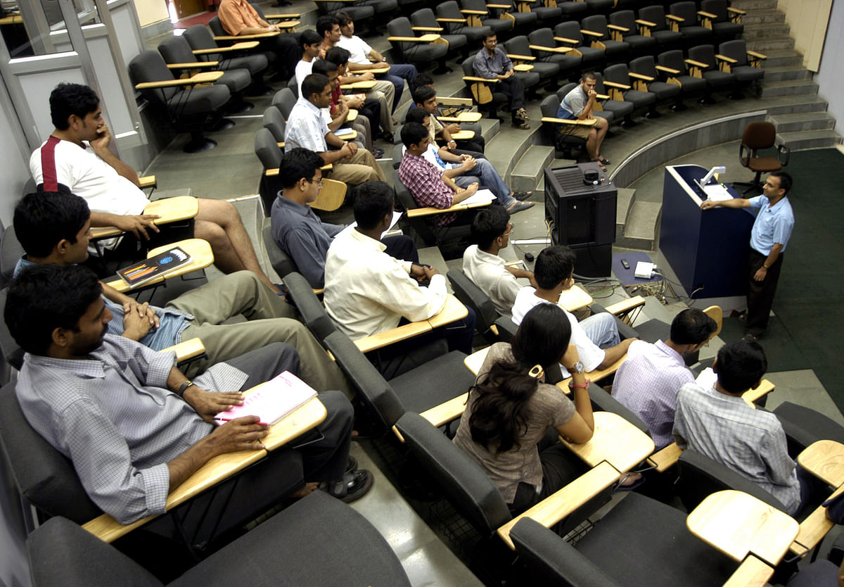 Students attend a lecture in the Seminar Hall at the Indian Institute of Technology, Bombay in Mumbai (Photographer: Santosh Verma/ Bloomberg News)