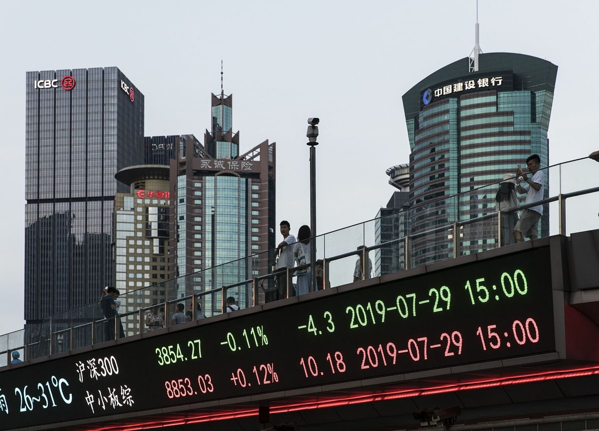 China Scraps Foreign Investment Limit in Stocks and Bonds