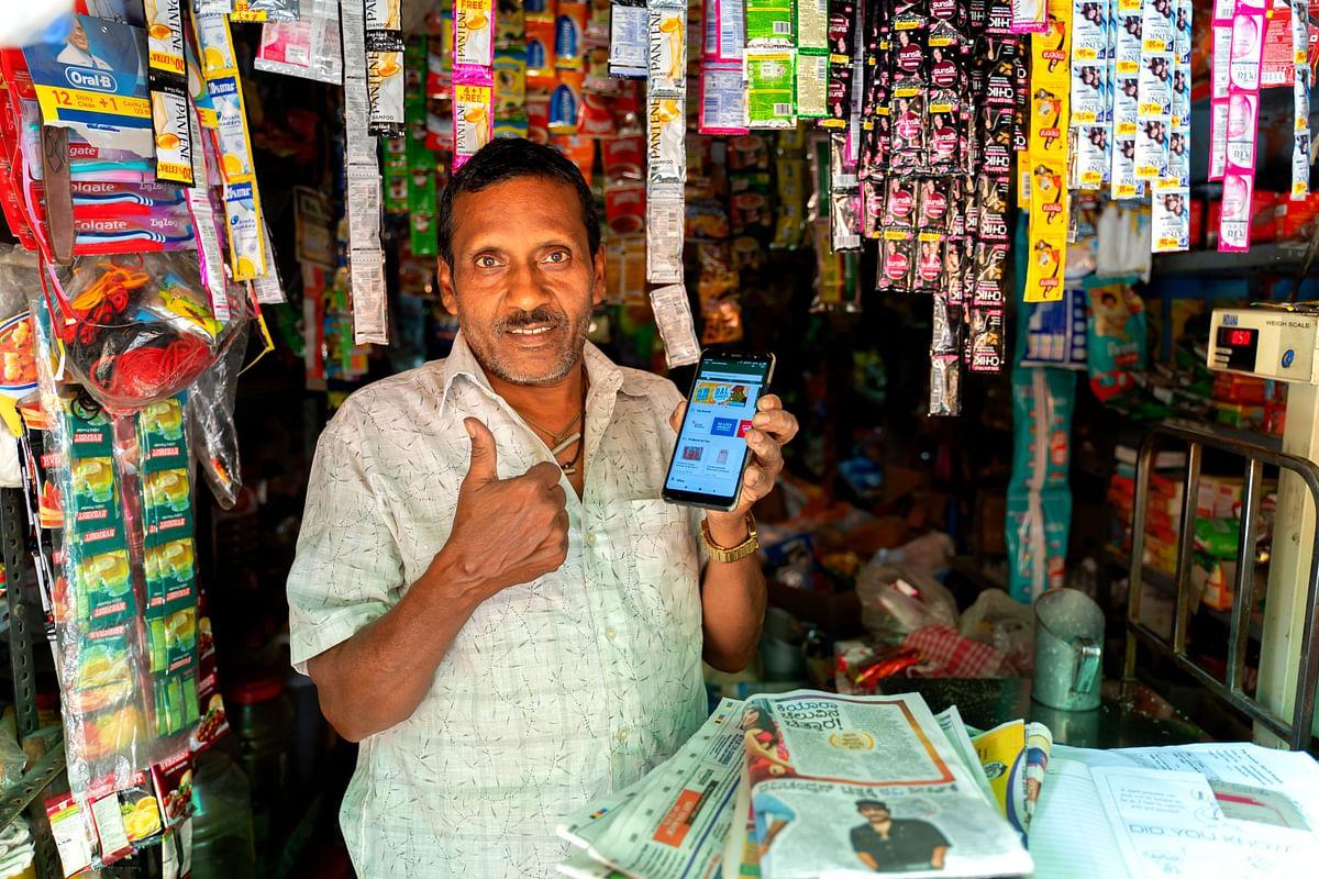 A kirana store owner using the Jumbotail application. (Source: Jumbotail)