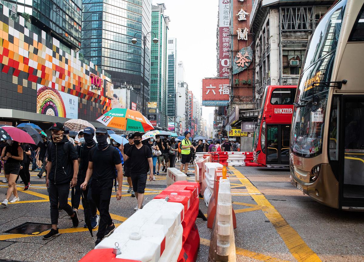 Hong Kong Activist Renews Call for March After Hammer Attack