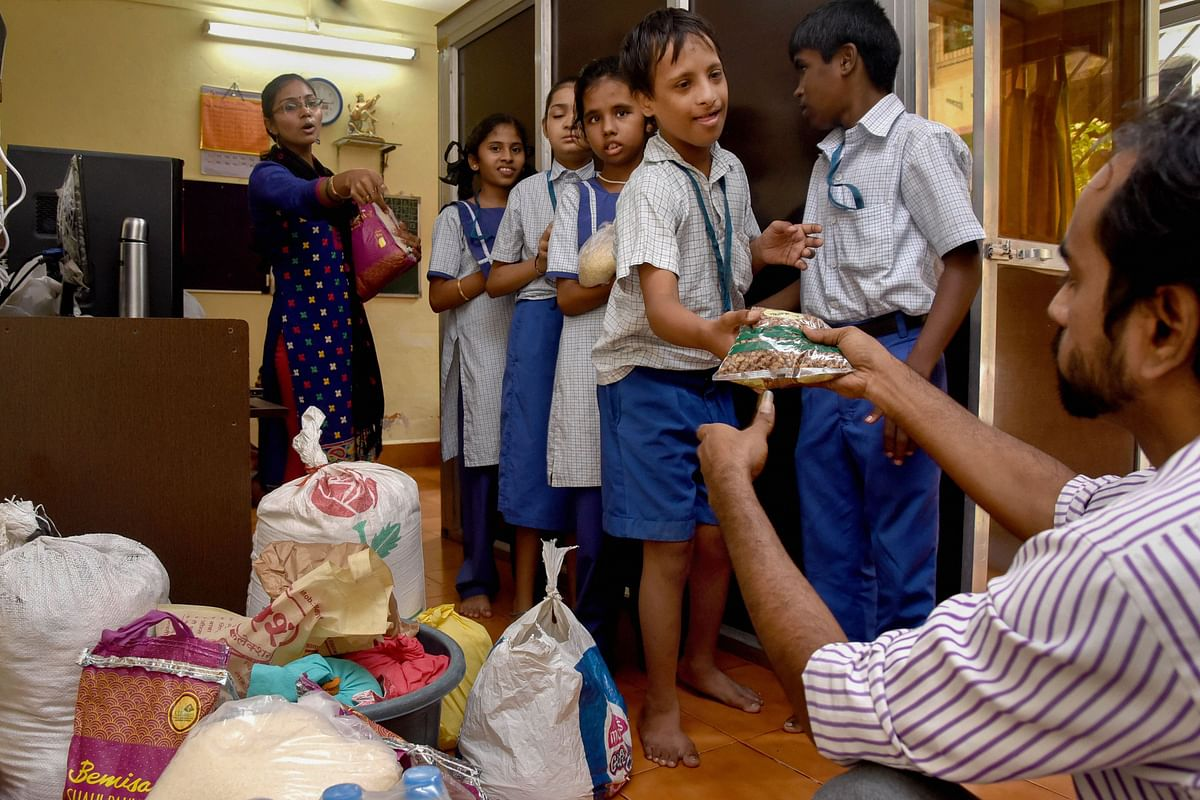 Specially-abled children donate food packets for the flood-affected, in Navi Mumbai, on Aug. 13, 2019. (Photograph: PTI)