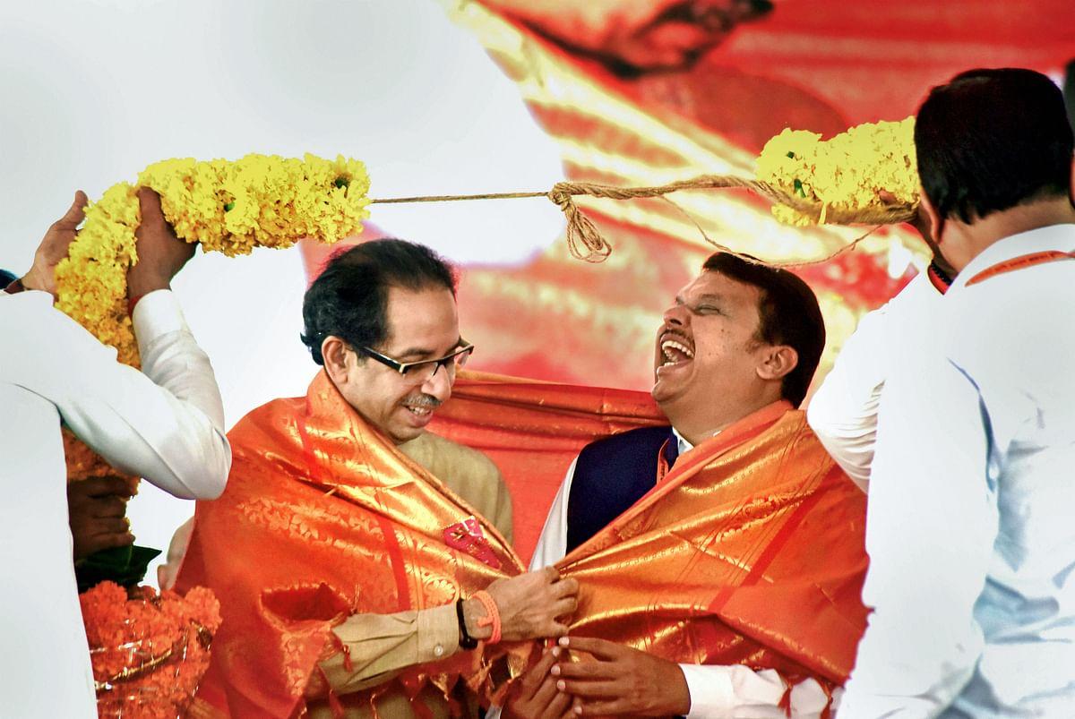 Uddhav Thackeray and Devendra Fadnavis, in Navi Mumbai, on Sept. 25, 2019. (Photograph: PTI)