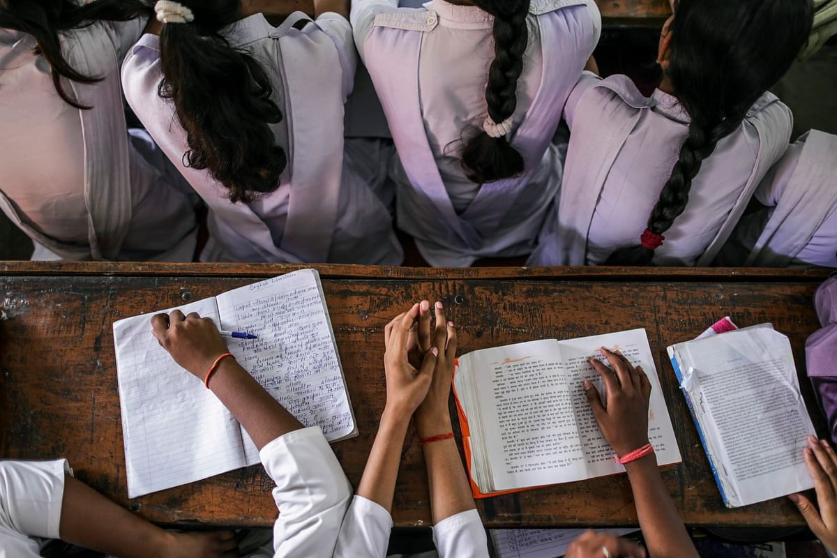Students sit studying at a college in, Uttar Pradesh. (Photographer: Dhiraj Singh/Bloomberg)