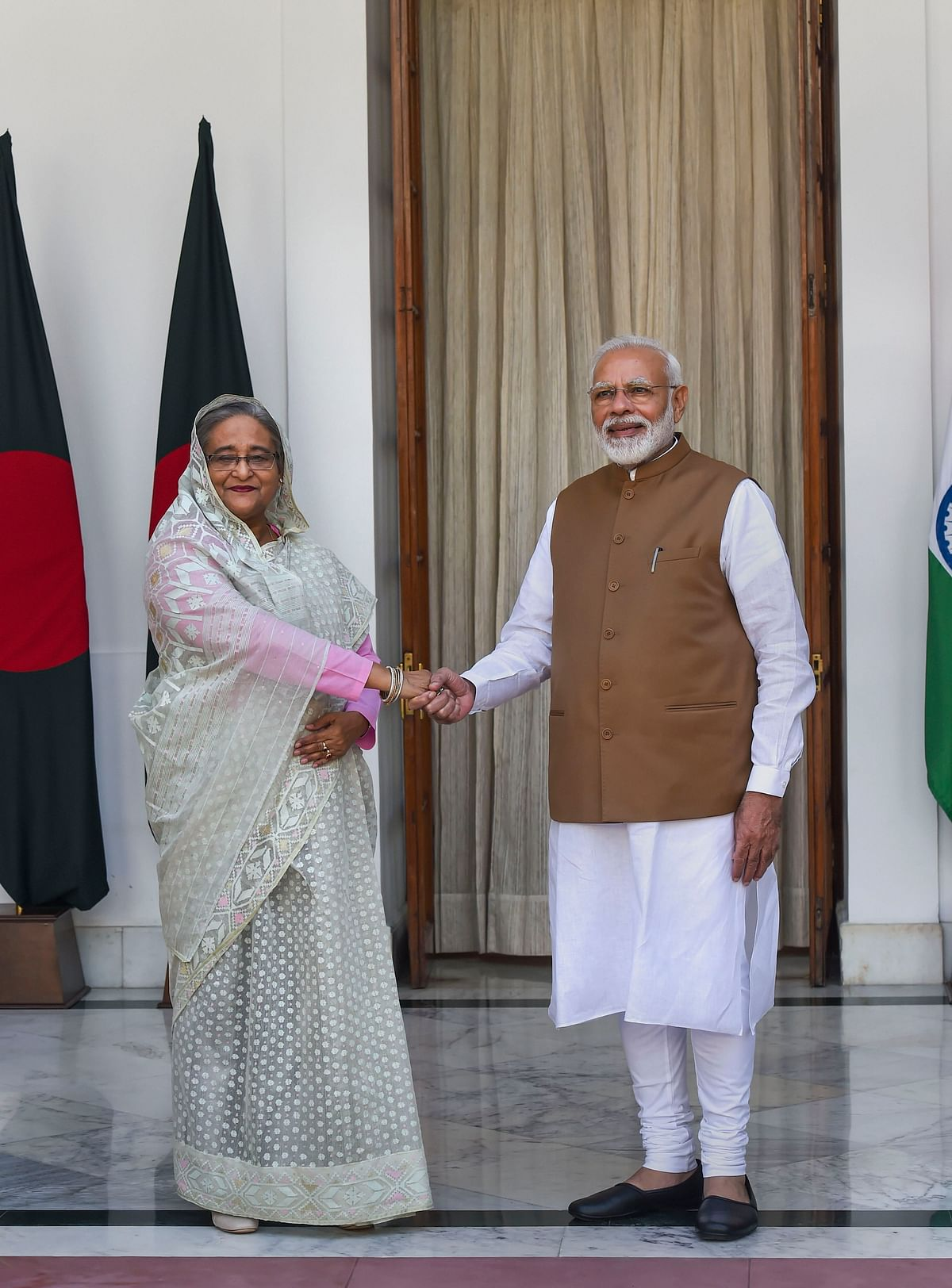 Prime Minister Narendra Modi shakes hands with his Bangladeshi counterpart Sheikh Hasina prior to a meeting at Hyderabad House in New Delhi, on Oct. 5, 2019. (Photographer: Atul Yadav/PTI)