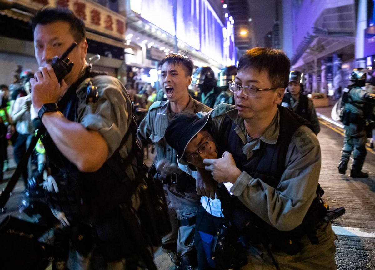 Hong Kong Police Officer Slashed in Neck as Violence Continues