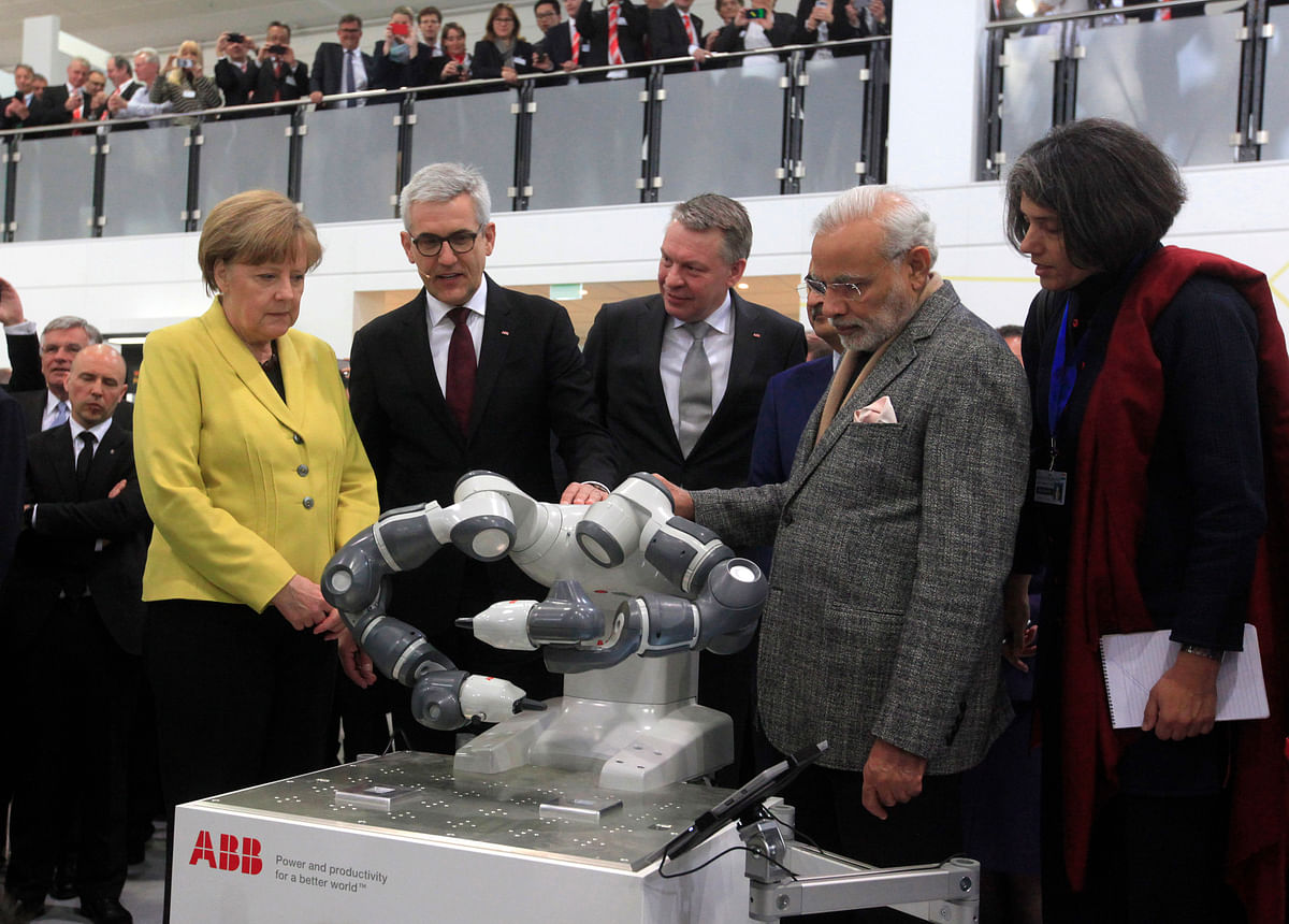 Angela Merkel, Germany's chancellor, and Narendra Modi, India's prime minister, at the industrial fair in Hanover, Germany, on April 13, 2015. (Photographer: Krisztian Bocsi/Bloomberg)
