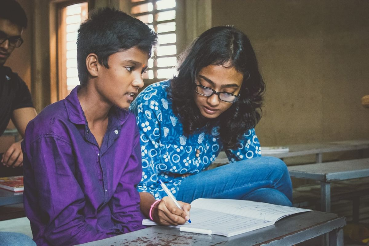 A volunteer and child at an education support class in Hyderabad. (Photograph: Make A Difference)