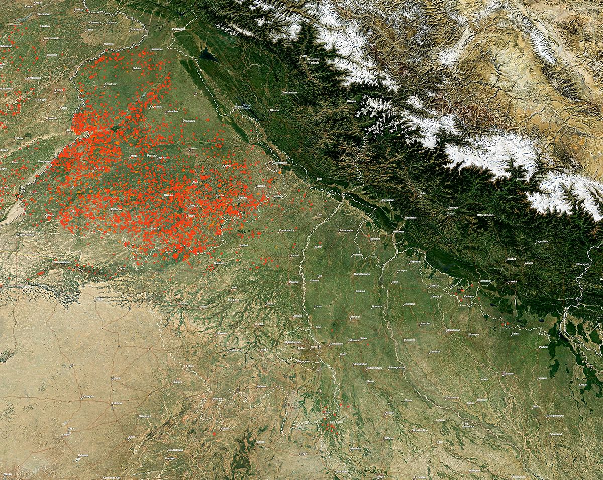 NASA image released on Wednesday afternoon showing red dots indicating fires, including those due to stubble burning, in areas surrounding Delhi and rest of North India. (Source: PTI)