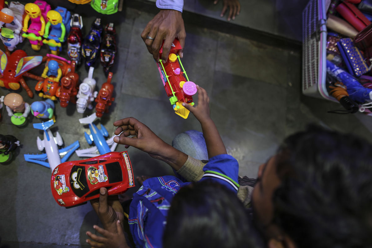 A customer browses toys at a store in Mumbai. (Photographer: Dhiraj Singh/Bloomberg)