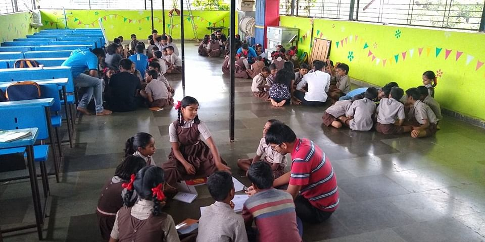 Outreach volunteers with school children in Mumbai. (Photograph: Cognizant)