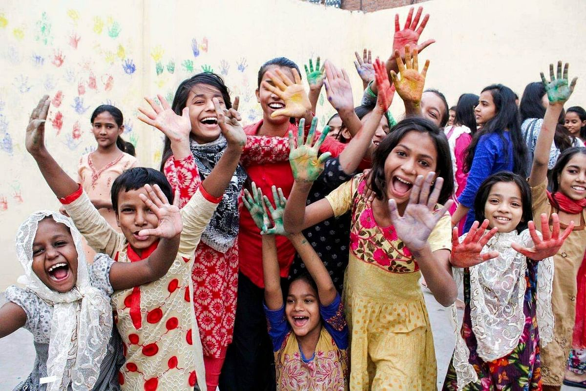 Children and  volunteers celebrate Holi in Delhi. (Photograph: Make A Difference)