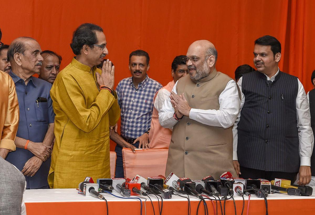 Amit Shah greets Uddhav Thackeray after announcing the BJP - Shiv Sena alliance, in Mumbai, on Feb. 18, 2019. (Photograph: PTI
