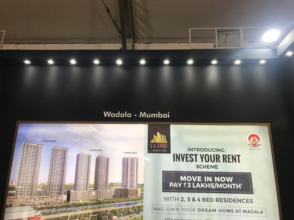 A hoarding advertising Ajmera Realty's Invest You Rent Scheme at the property expo (Source: BloombergQuint)