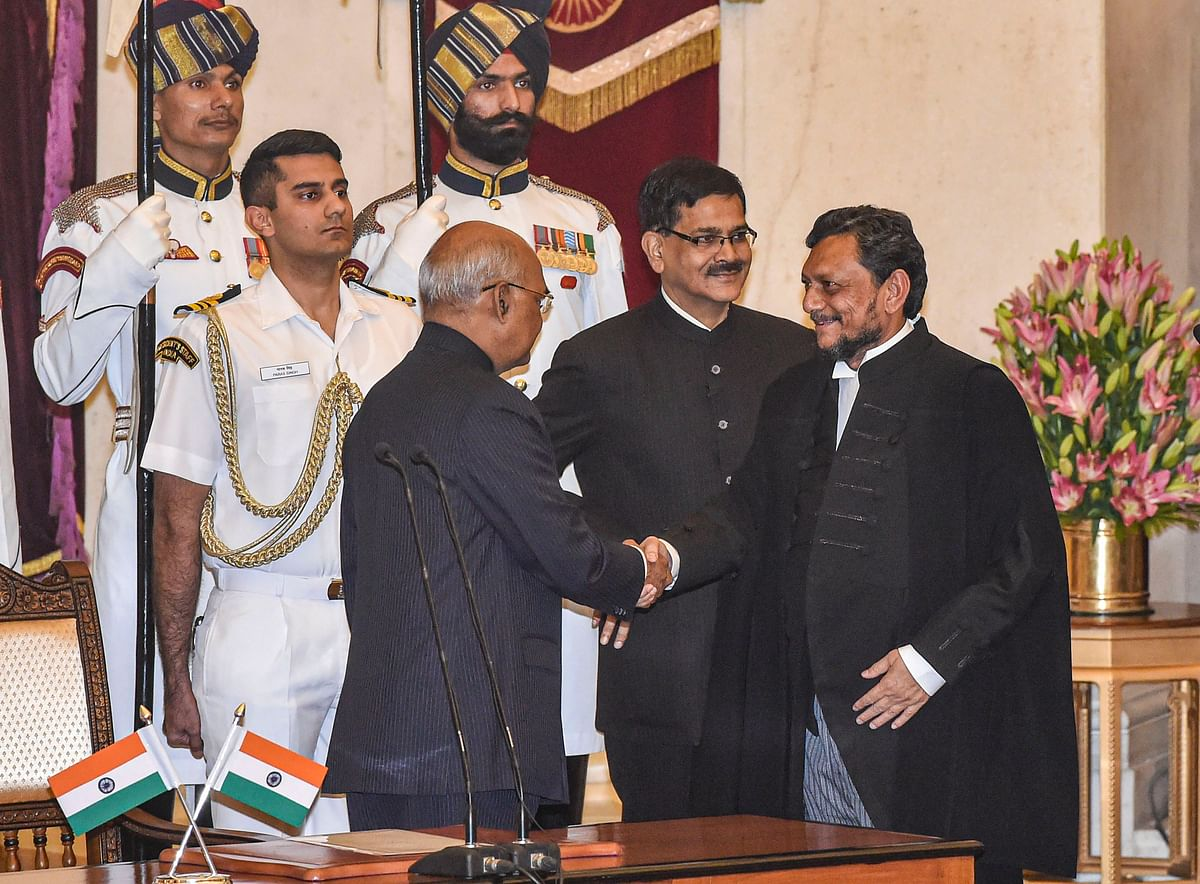 President Ram Nath Kovind shakes hands with Justice Sharad Arvind Bobde after he took oath as the 47th Chief Justice of India (CJI) at Rashtrapati Bhavan, in New Delhi, Monday, Nov. 18. (Source: PTI)
