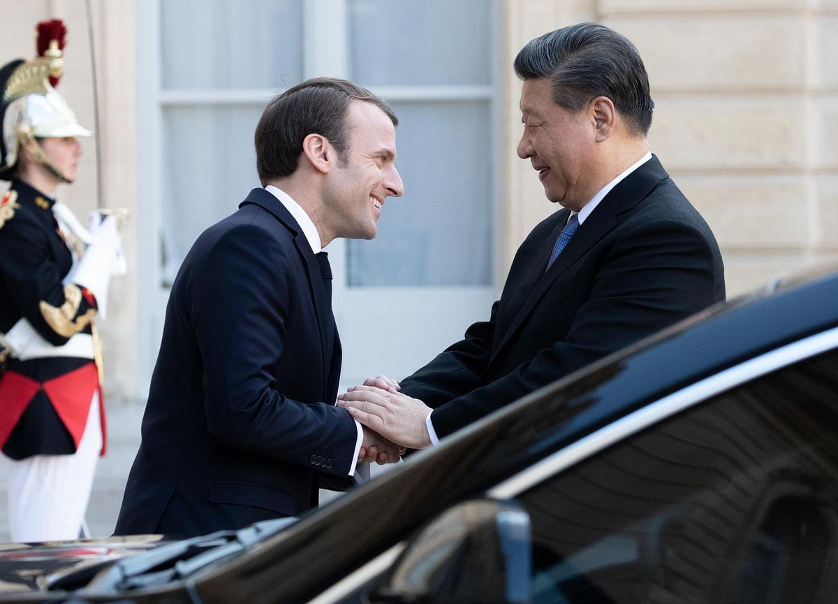 Macron, Xi Pledge to Uphold Free Trade During China Visit