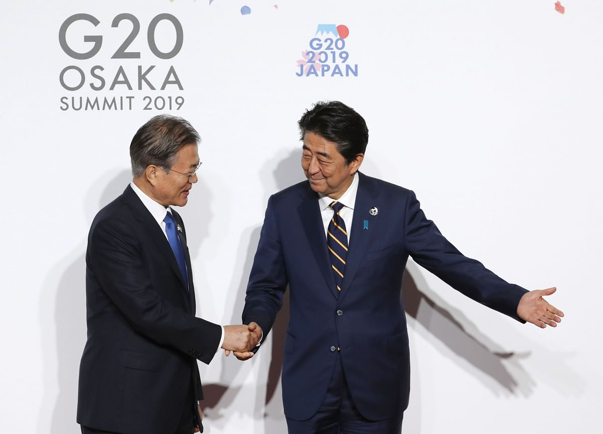 Abe, Moon Break Ice After Worst Japan-South Korea Fight in Years