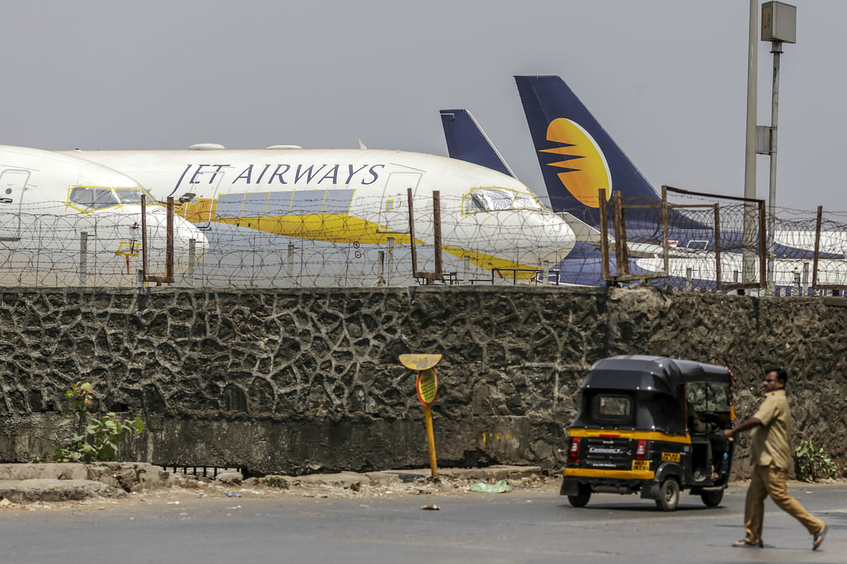 Jet Airways aircraft sit on the tarmac at the airport in Mumbai. (Photographer: Dhiraj Singh/Bloomberg)