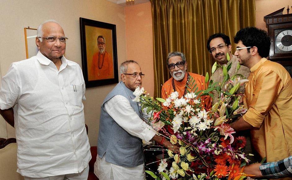 Sharad Pawar and Pranab Mukherjee, with the Thackeray family, in Mumbai, on July 13, 2012. (Photograph: PTI File Photo)