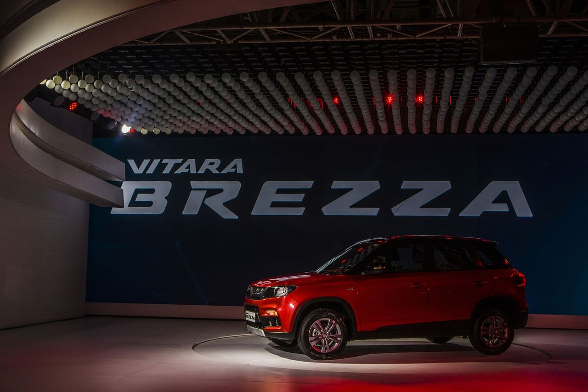 A Maruti Suzuki India Ltd. Vitara Brezza stands on display during its launch at the Auto Expo 2016 in Noida, Uttar Pradesh, India. (Photographer: Prashanth Vishwanathan/Bloomberg)