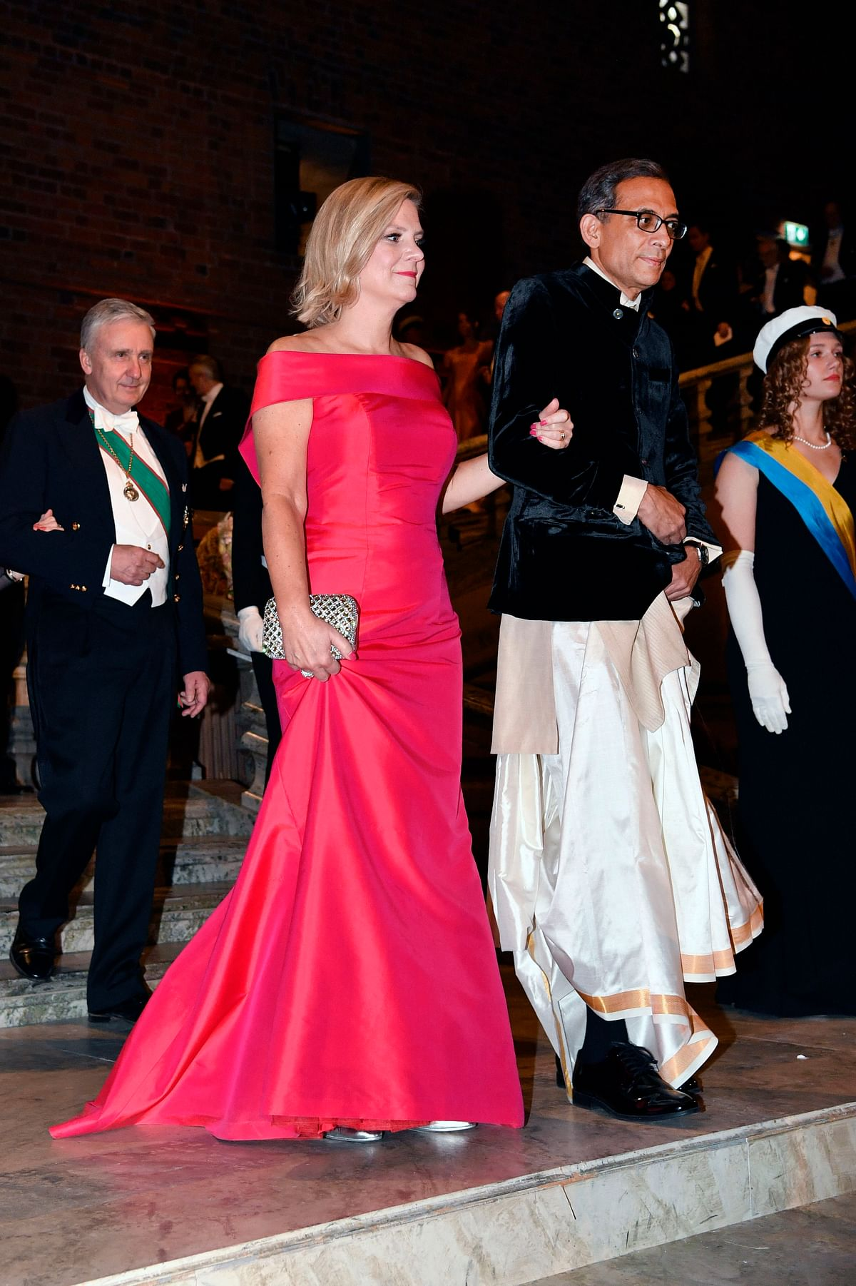Swedish Finance Minister Magdalena Andersson and Economics Laureate Abhijit Banerjee arrive to the Nobel banquet at Stockholm City Hall, in Stockholm, Sweden, on Dec. 10, 2019. (Photo: PTI)