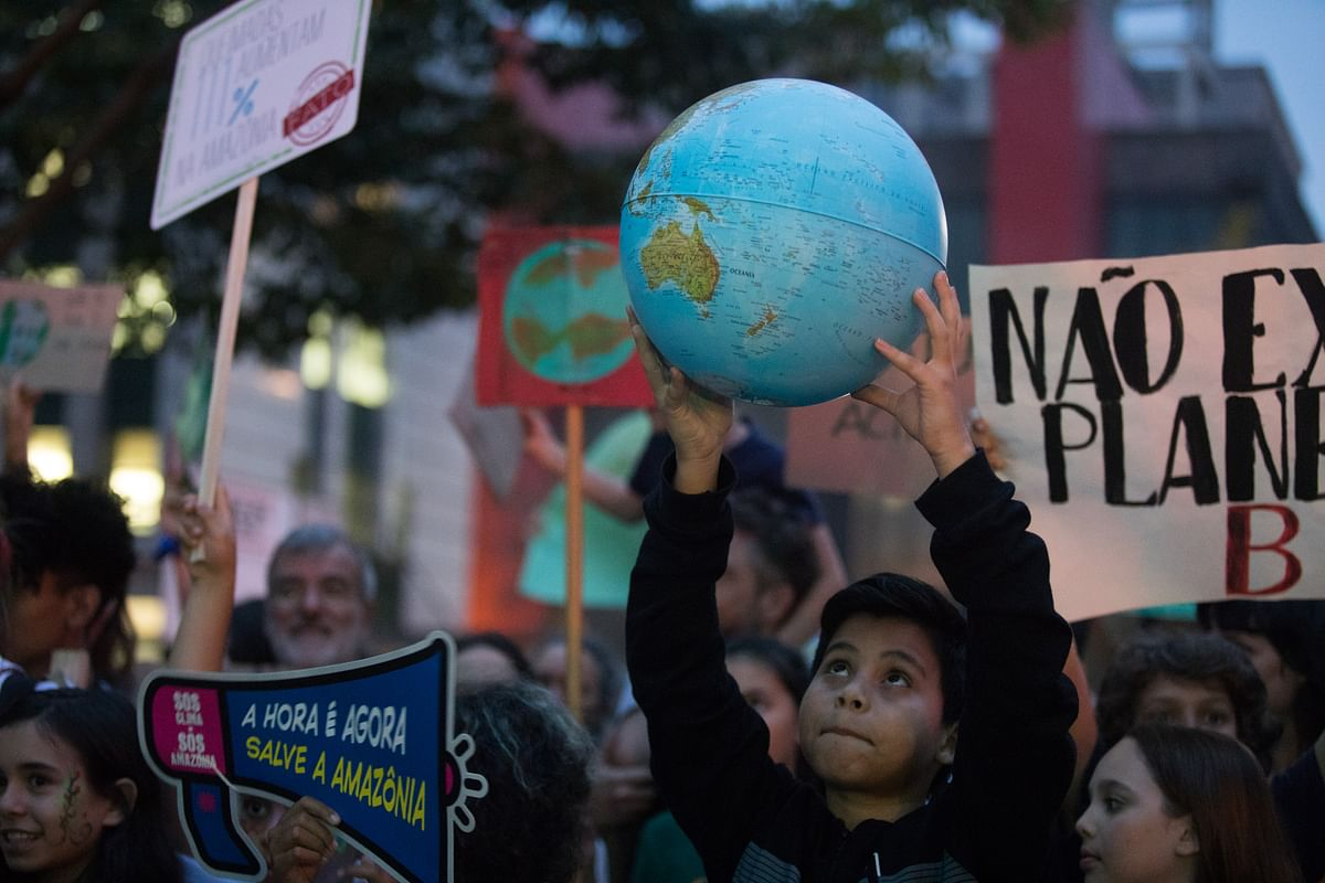A child holds a globe during the Global Climate Strike demonstration in Sao Paulo, Brazil. (Photographer: Patricia Monteiro/Bloomberg)